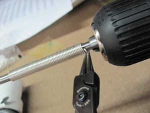 using pliers to remove the wire from the mandrel hole