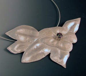 dogwood blossom in solid sterling silver with Mystic Topaz