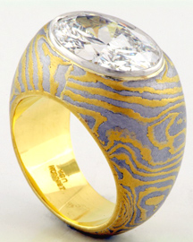 Shell formed Ring in 22k and Iron mokume gane with diamond