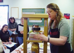 Cynthia Eid teaching a hydraulic press workshop