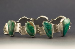 Bracelet with 7 chrysocolla cabochons.
