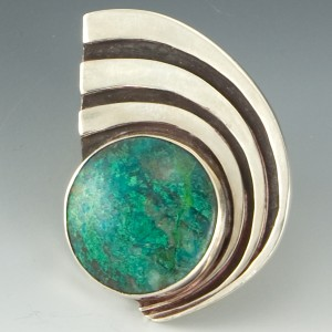 Pendant with round chrysocolla cabochon.