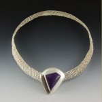 Sterling silver woven wire necklace with clasp featuring a sugilite cabochon