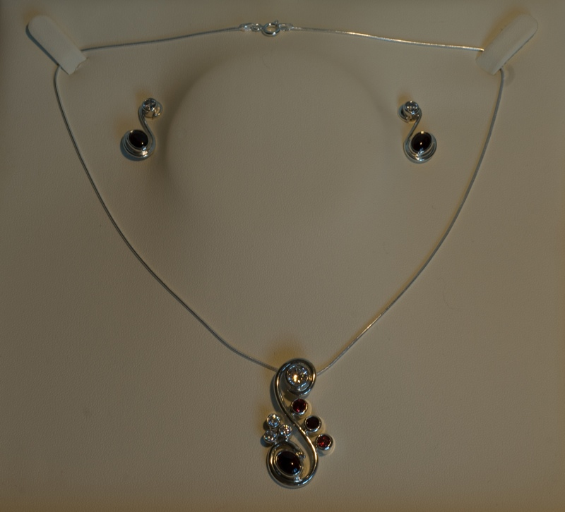 Sterling silver, Indian garnet and cubic zirconia pendant and earrings