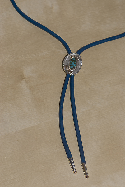Sterling silver and recycled 9K gold, Chinese turquoise bola tie on blue leather cord