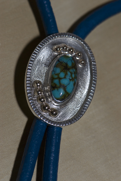 Sterling silver and recycled 9K gold, Chinese turquoise bola tie