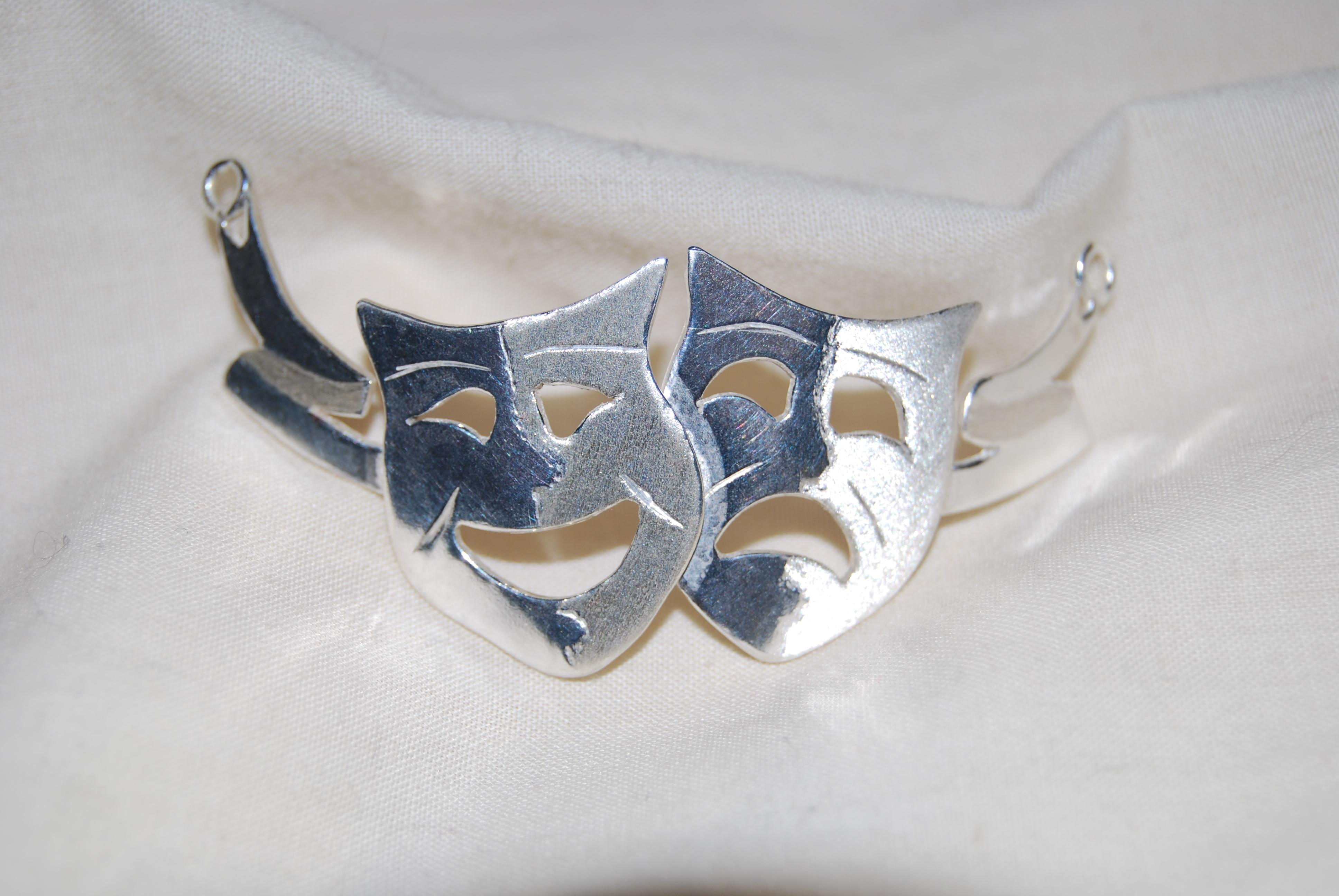 Sterling silver drama masks necklace
