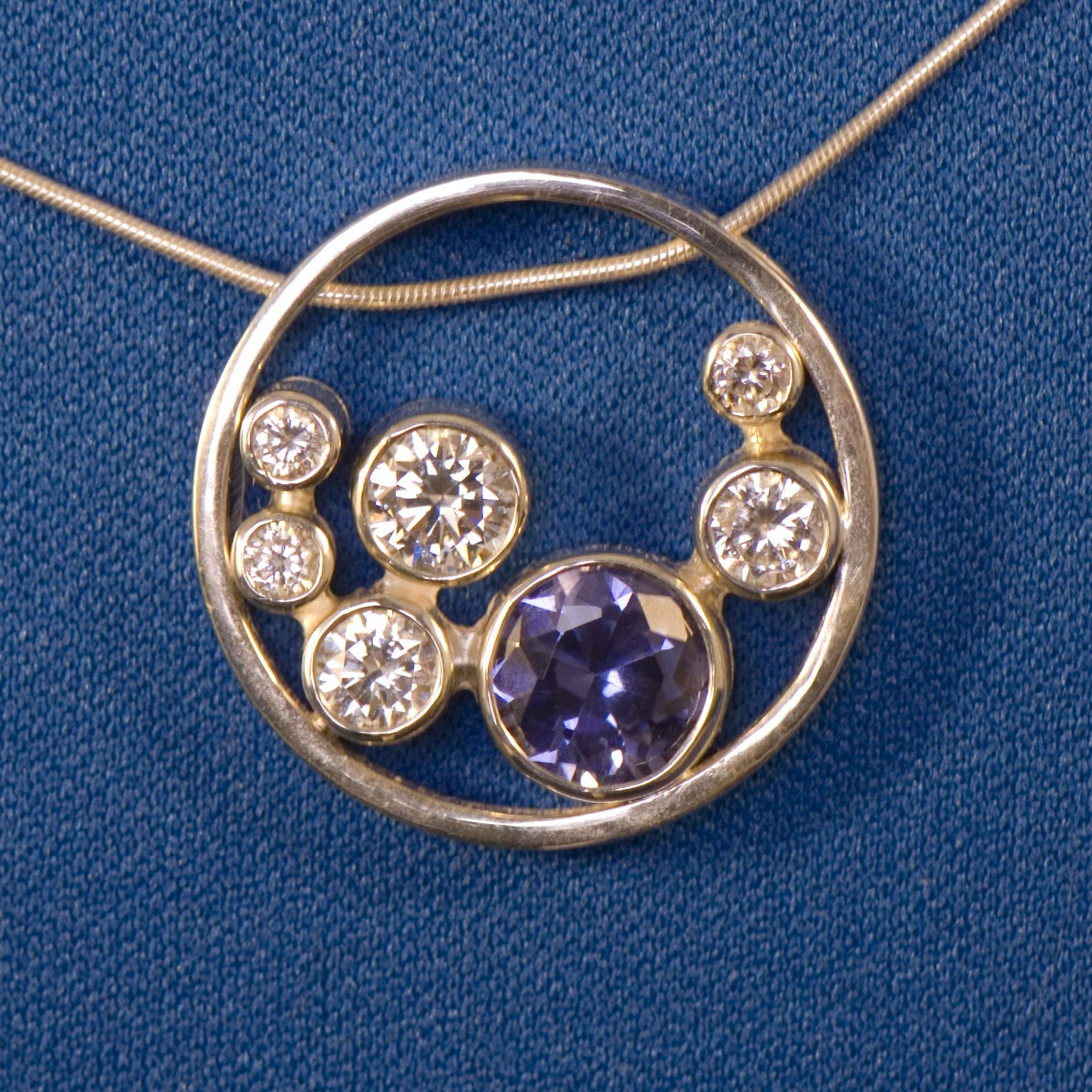 Lab tanzanite and CZ circle pendant