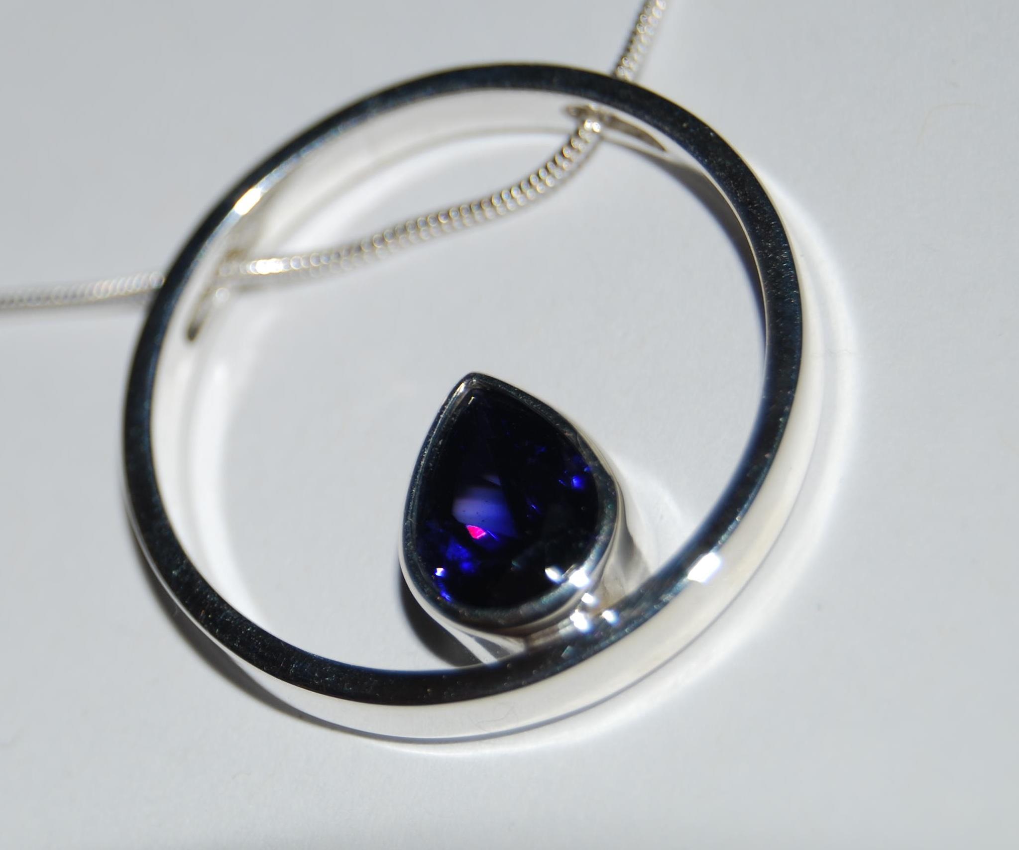 Lab tanzanite circle pendant