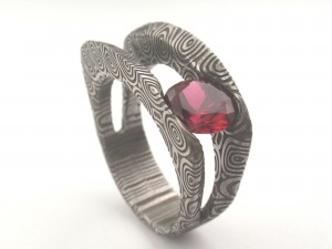 Damascus with Birds Eye pattern and ruby