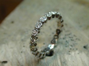 A diamond eternity band made in platinum.