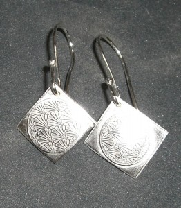 Roller printed, domed, and soldered earrings by Nancy.
