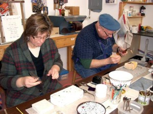 Mary Jo and Mo at the soldering station.