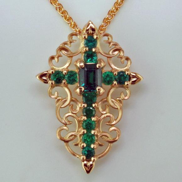 La LechugaA Cross of Colombian Emeralds in Peach Gold Mardon