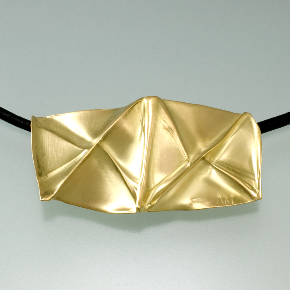 Gold And Silver Jewelry Made With The Technique Of Fold