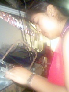 craftswomann with jewelry saw