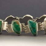 Bracelet with 7 chrysocolla cabochons.