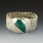 Woven bracelet with a chrysocolla cabochon.